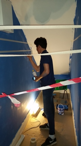 Painting the book nook with Senior Helper Sam